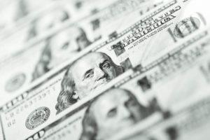 dollar banknotes piled