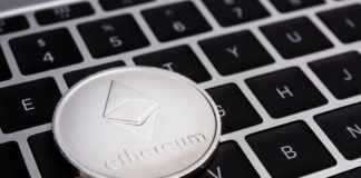 Ethereum coin on top of keyboard