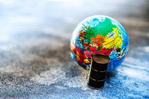 miniature globe and oil drum concept