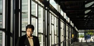 asian stocks a man looking at sheet for asian stocks
