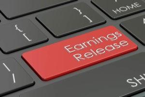 earnings release written on computer keyboard key