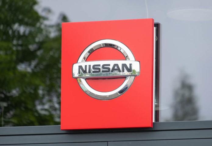 Wibest Broker — Carmaker: Nissan sign and logo.