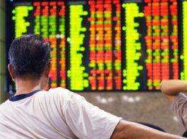 Man watching stock market index.