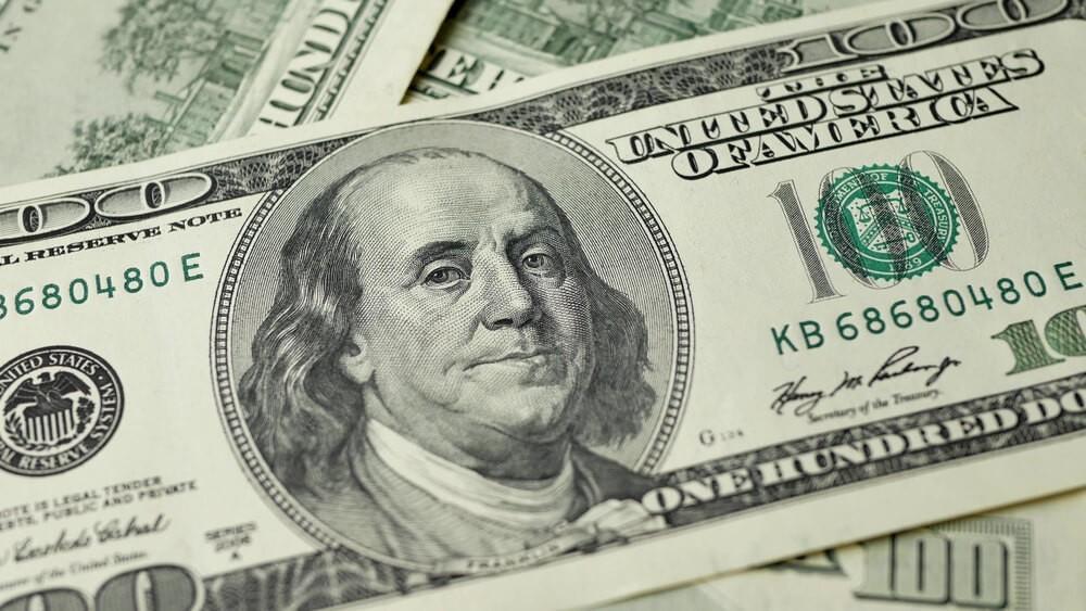 100 Dollars bill and portrait Benjamin Franklin on USA money banknote.