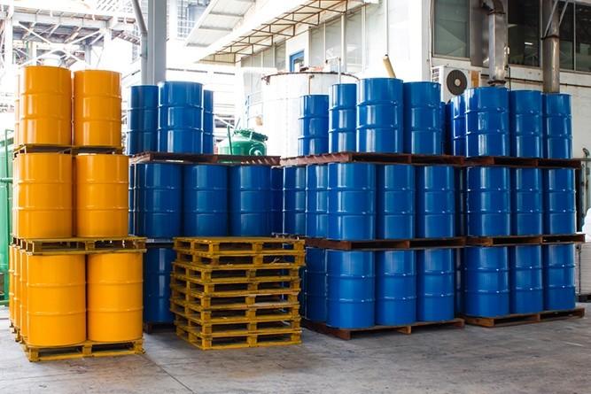 Wibest – Crude oil: oil barrels stacked together.