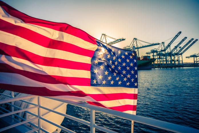 US flag over port