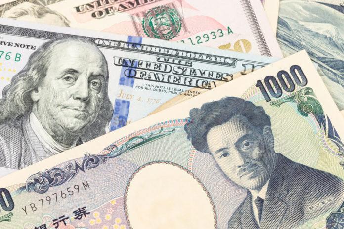 Wibest – Forex Markets: US Dollar and Japanese Yen banknote money.
