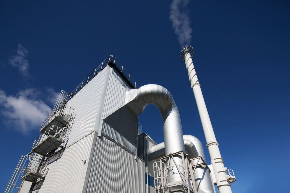 Biofuel Energy: Biofuel boiler house on a blue sky background