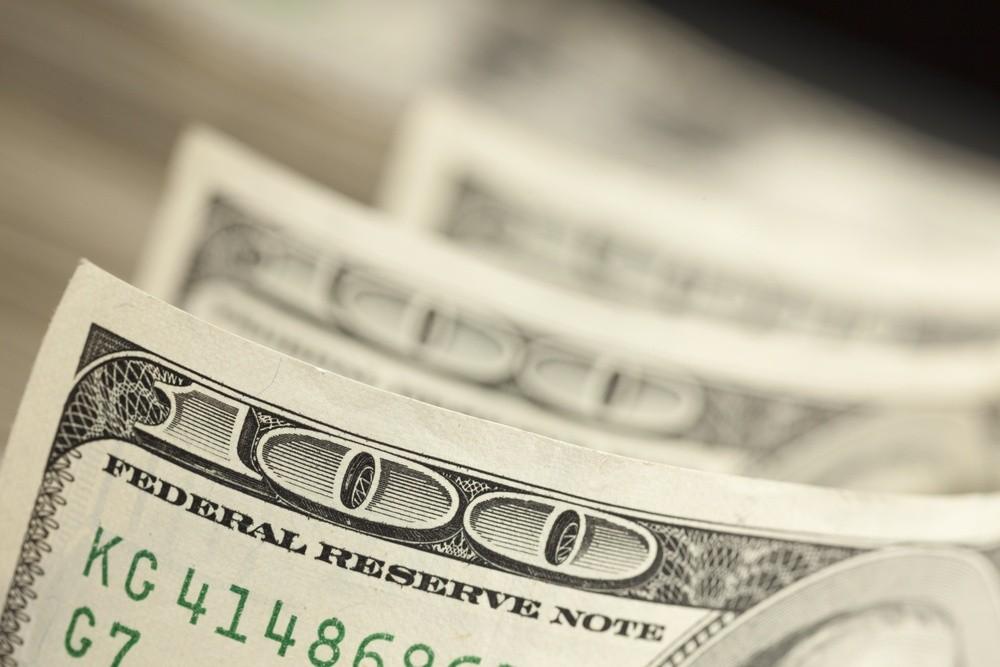 Wibest – fx market: A close up of a US dollar bill.