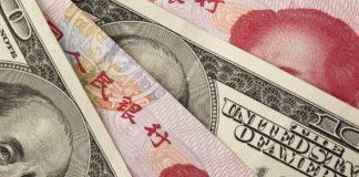 Forex Markets: Chinese yuan and US dollar bills.