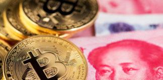 Bank of China: Bitcoin and banknotes of one hundred yuan close up.