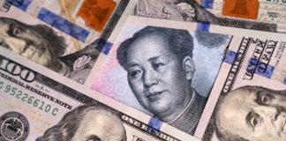 Wibest – Yuan: US dollar and Chinese yuan bills.