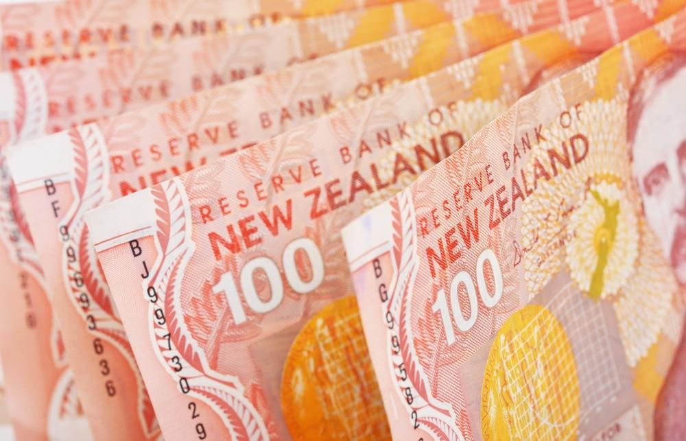 Wibest – NZD USD: One hundred New Zealand dollar bills.