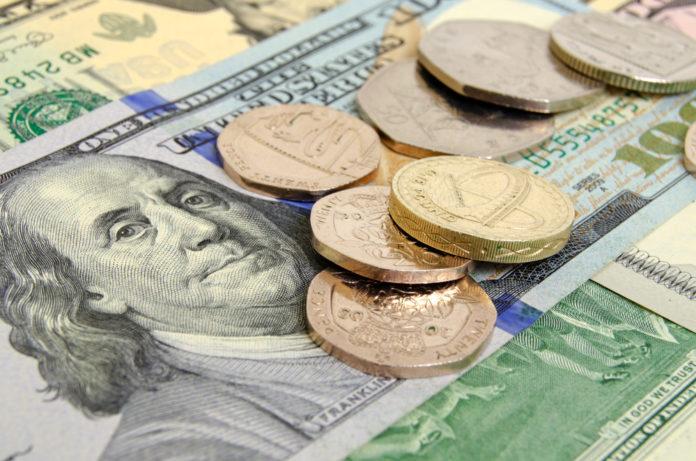 Wibest – GBPUSD: US dollar bills and British pound coins