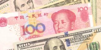 Forex Markets: Yuan and Dollar banknotes.