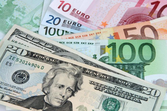 Wibest – EUR-USD: Euro and US dollar bills.