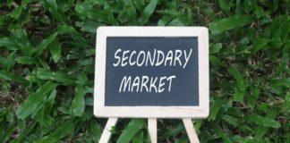 secondary market written on mini chalkboard - wibestbroker