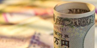Wibest – Japan Yen: A Japanese yen bill rolled up.