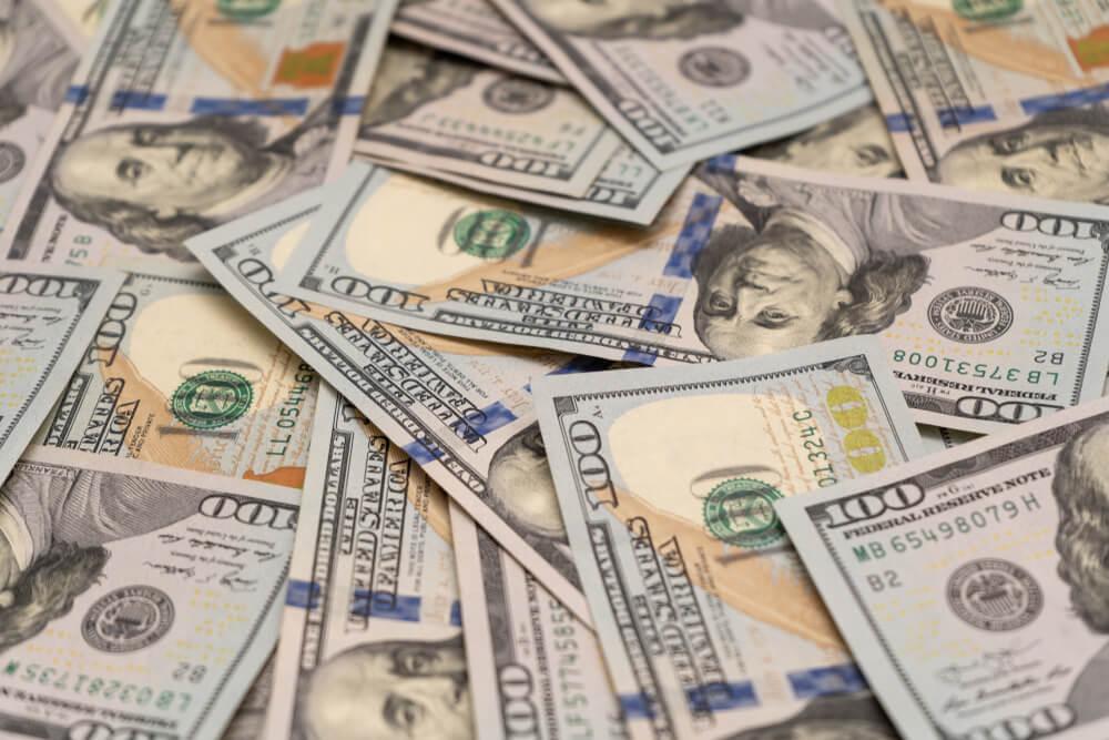 Wibest – Dollar Index: A pile of US dollar bills.