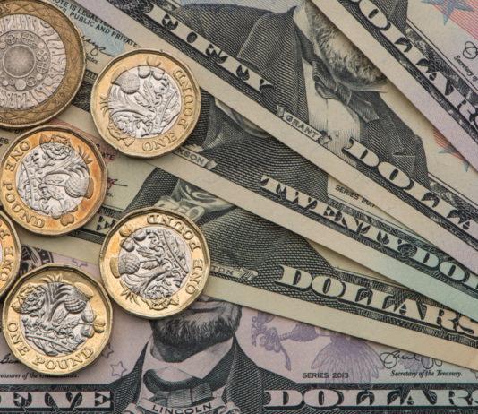 Wibest – GBPUSD: British pound sterling coins over US dollar bills.