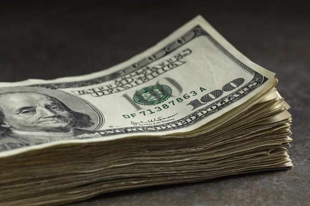 Wibest – GBPUSD: A stack of hundred-dollar bills.