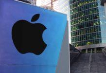 Apple: Street signage board with Apple Inc. logo.