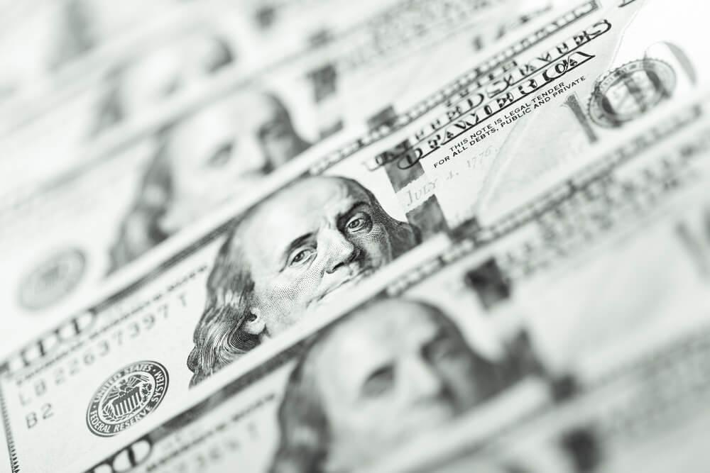 Wibest – Dollar Index: A close up shot of greenback bills.