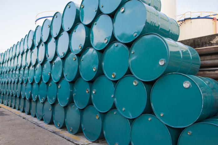 Wibest – WTI Crude: Crude oil barrels stacked together.