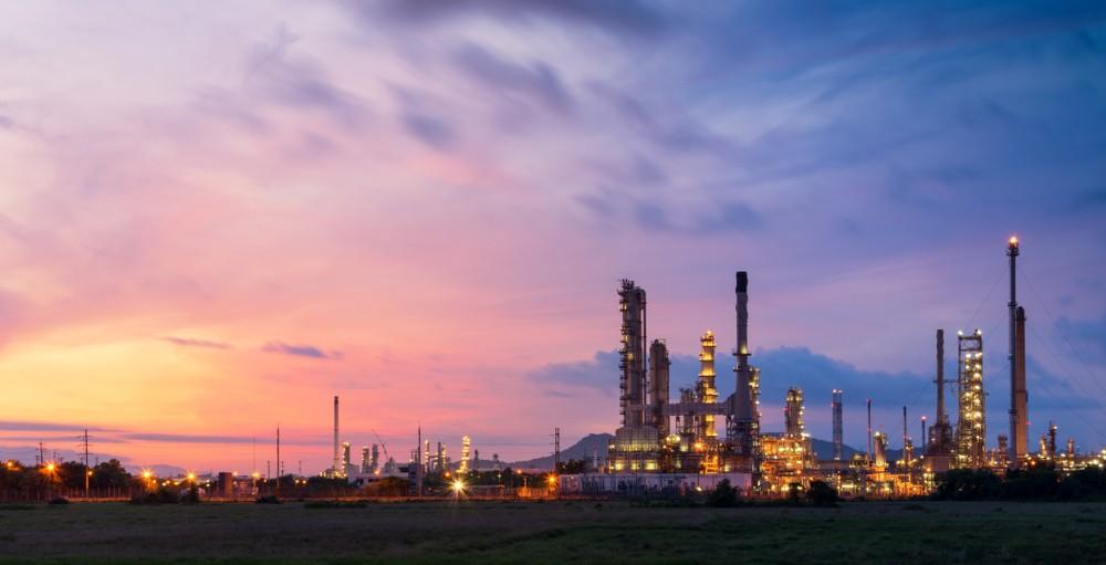Wibest – Oil Petroleum: An oil refinery over a purple sunset.