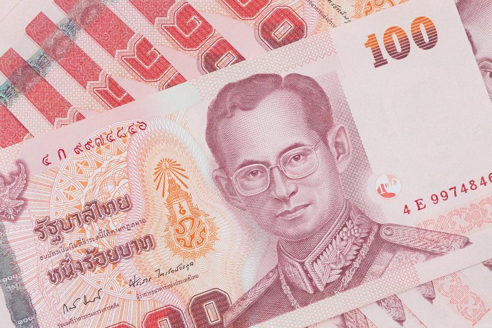 Wibest – Thai: A close up of a Thai baht bill.