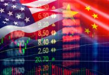 American: Trade war economy USA America and China flag candlestick graph
