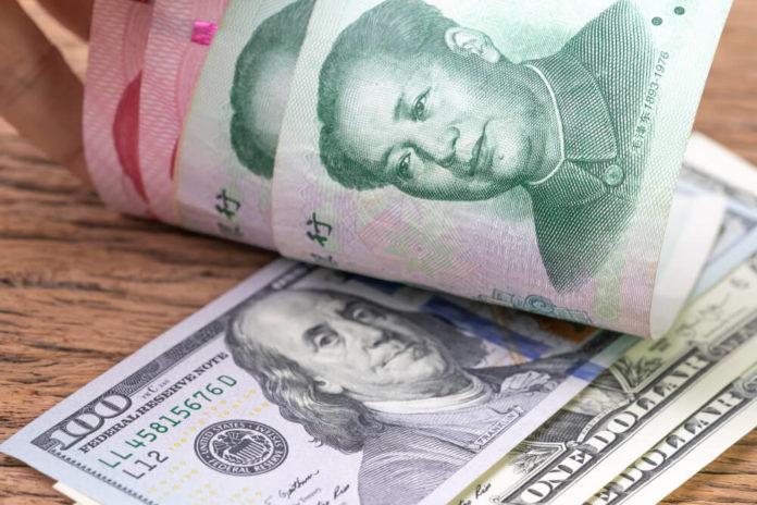 Asian Market: US dollar banknotes face up to Chinese Yuan banknotes