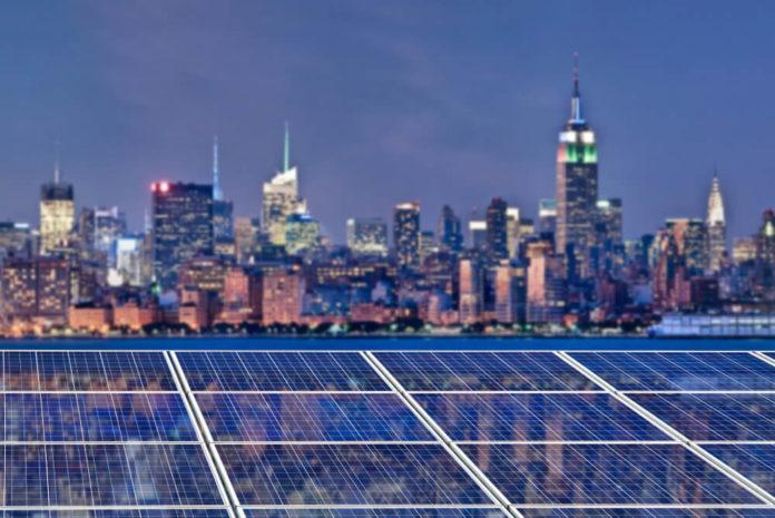 US Futures: New York skyline illuminated at night in the background