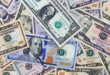 Wibest – USD Exchange Rate: US dollar bills.