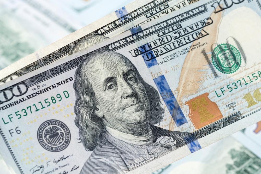 Wibest – The Greenback: US dollar bills.