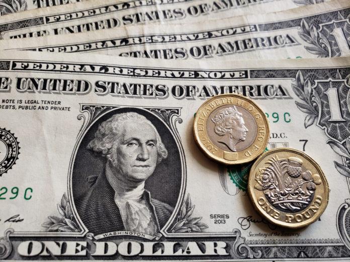 Wibest – GBP USD: US dollar bills and British pound coins.