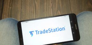 TradeStation: TradeStation Group, Inc logo displayed on smartphone.
