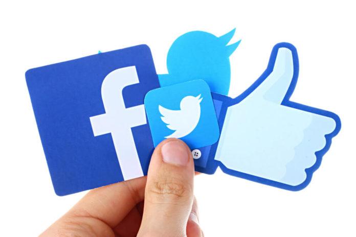 Twitter: Facebook, twitter in hand.