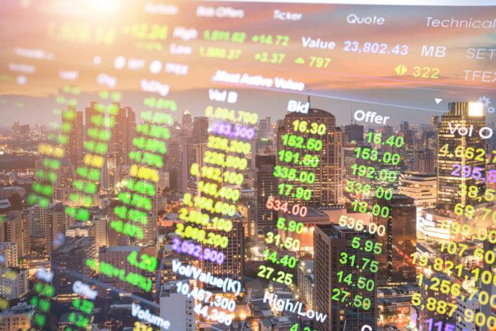 Asian Stock Market: Stock Market on the cityscape at night background.