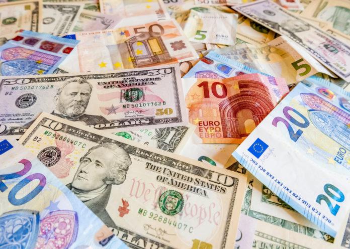 Wibest –Eurozone: Euro and US dollar bills.