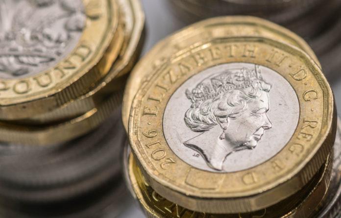 Wibest – Pound Money: British pound coins stacked up.