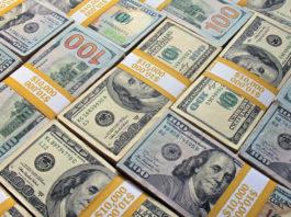 Wibest – USA Jobs: US dollar bills stacked and organized.