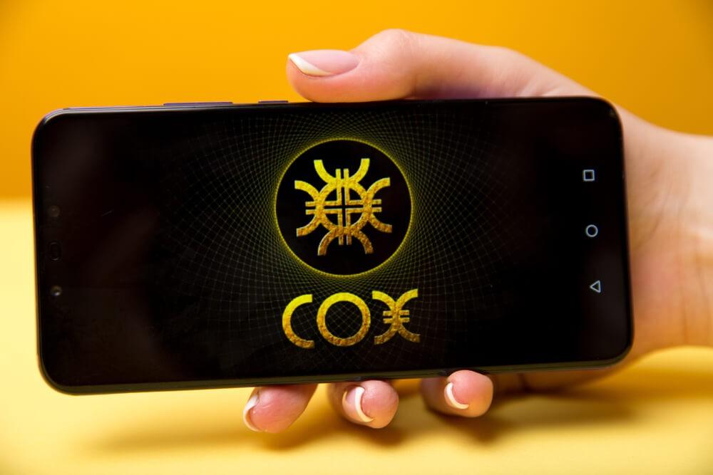 Cox: Cox on the phone display.