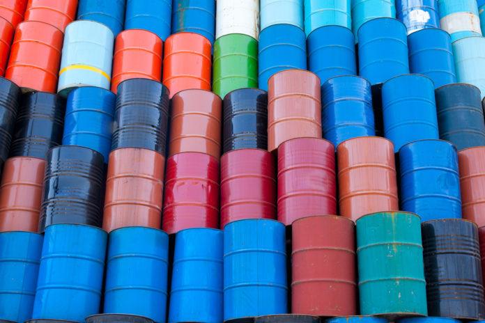 Wibest – Oil Petroleum: Crude oil barrels stacked up.
