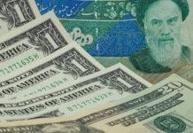 Wibest – Tehran: Iranian rial and US dollar bills.