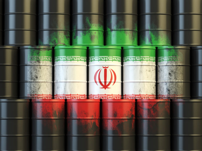 Wibest – Tehran: Crude oil barrels and the Iranian flag.