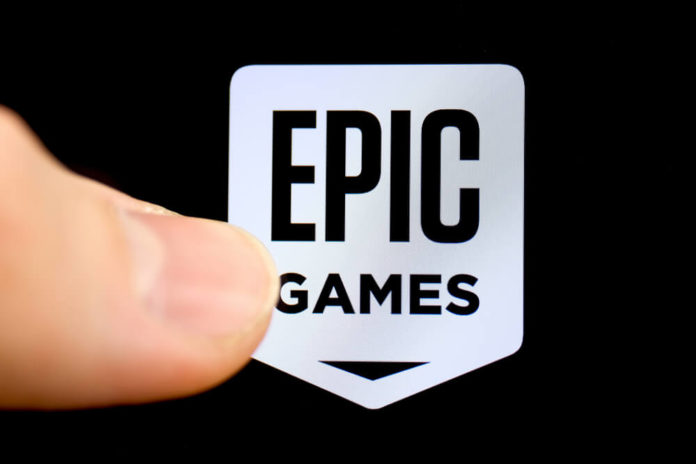 American company Epic Games on the smartphone with finger.