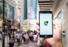google, A man hand holding screen shot of google maps app showing on LG G4.