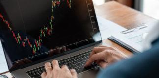 businessman or broker looking at computer laptop