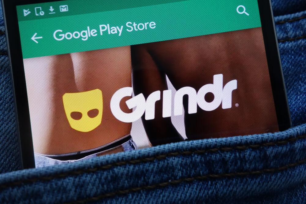 Grindr app on Google Play Store website displayed on smartphone.